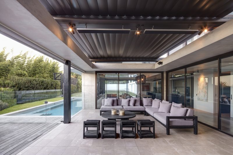 Outdoor-Entertaining-Area-With-View-To-Pool-And-Privacy-Screening